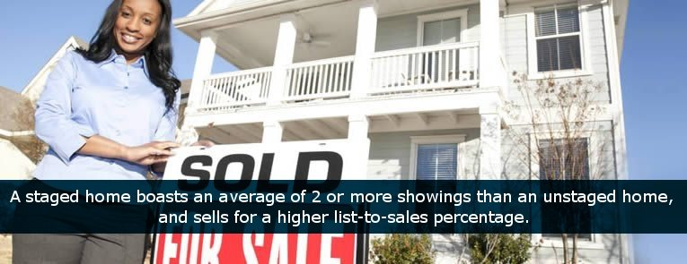 Real estate agent with SOLD for sale sign in front of house