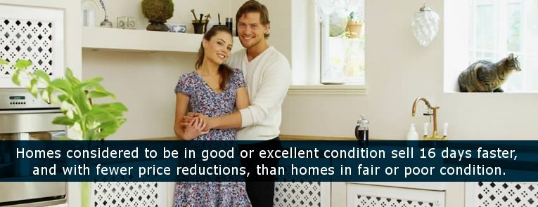 Happy Couple embracing in kitchen of their home with cat