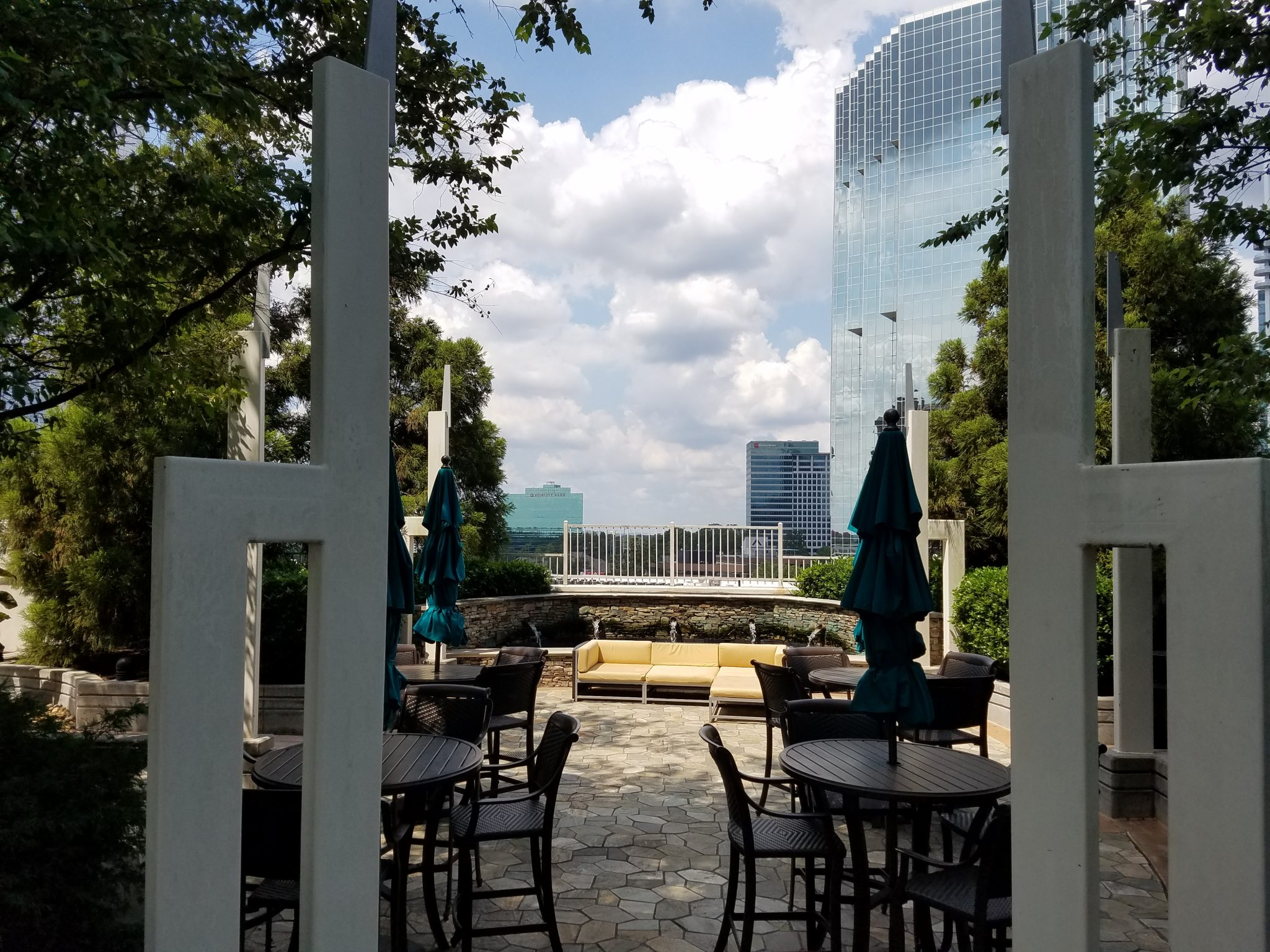 The Realm in Buckhead Outside Common Area with bar chairs and tables