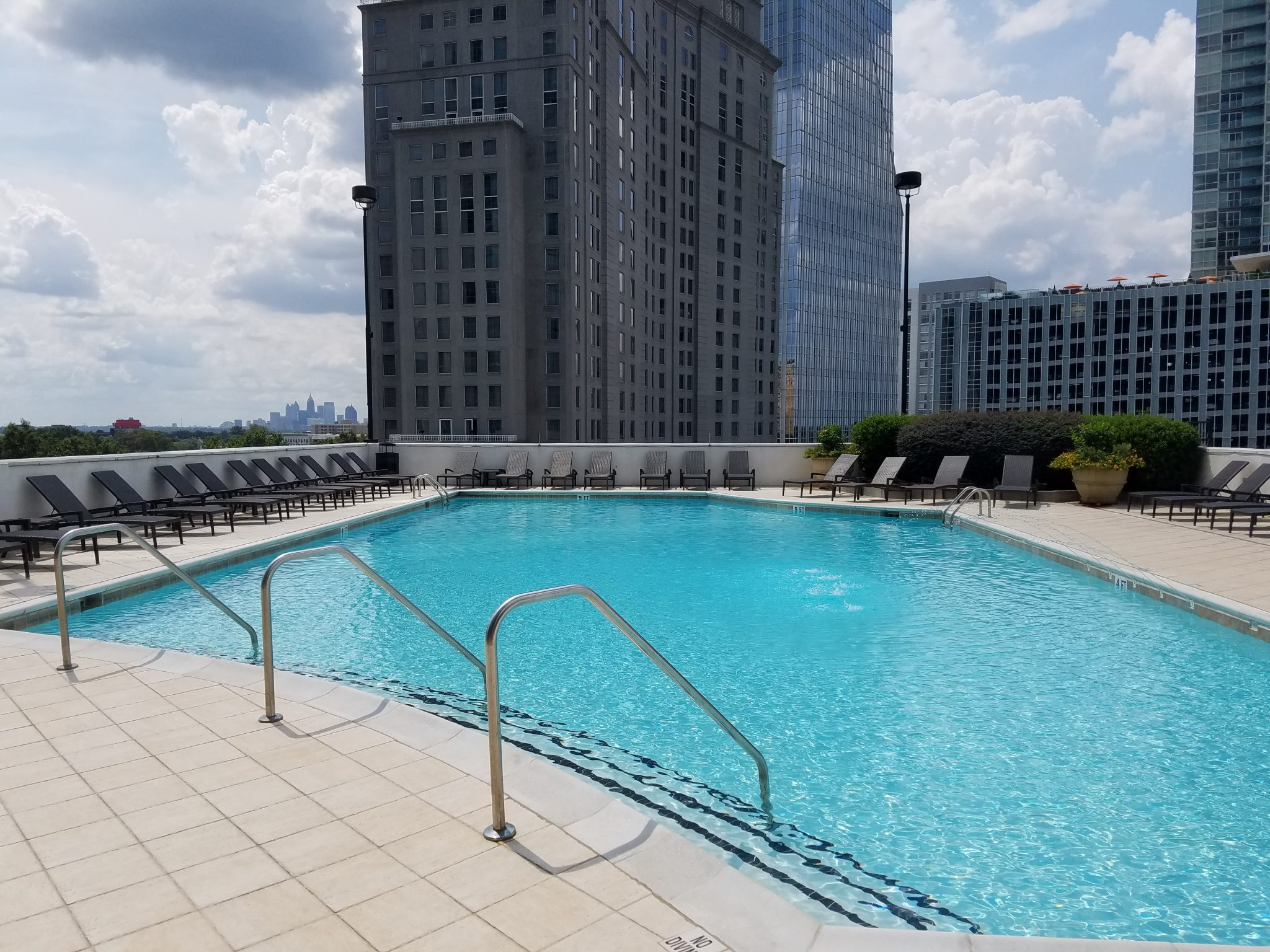 The Realm in Buckhead Swimming Pool with view of Downtown Atlanta in background